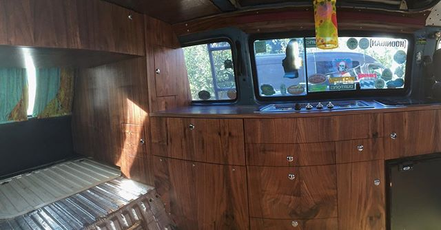 The picture is not best but here is the latest van build out. Made of balsa plywood and pre-finished maple plywood skinned with in house cut black walnut veneer. This build went far and beyond my previous builds with additions of the rear closet and over bed cabinet. Big thanks to Shane for ordering it and giving me some freedom to design something new. I'll have more picture soon. #robbyoungsfinewoodworking @robbyoungsfinewoodworking #vanagonlife