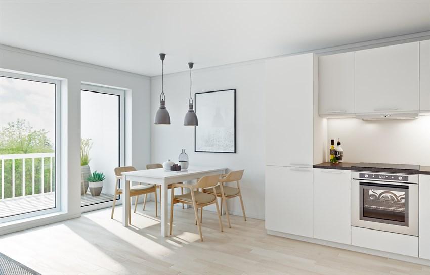 Utgang til hage/terrasse fra kombinert stue og kjøkken.