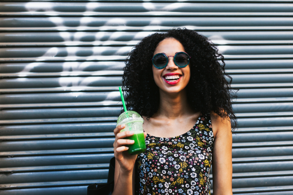 woman-drinking-green-smoothie-smiling