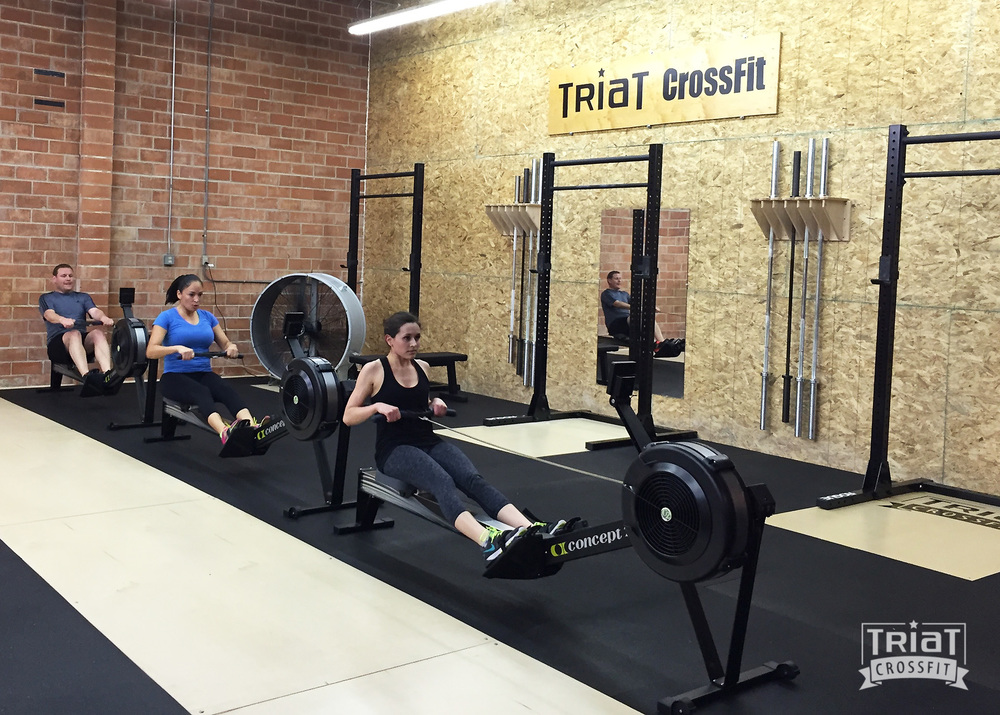 Caitlin, Jennifer & Matt closing out the WOD with a 1000m row