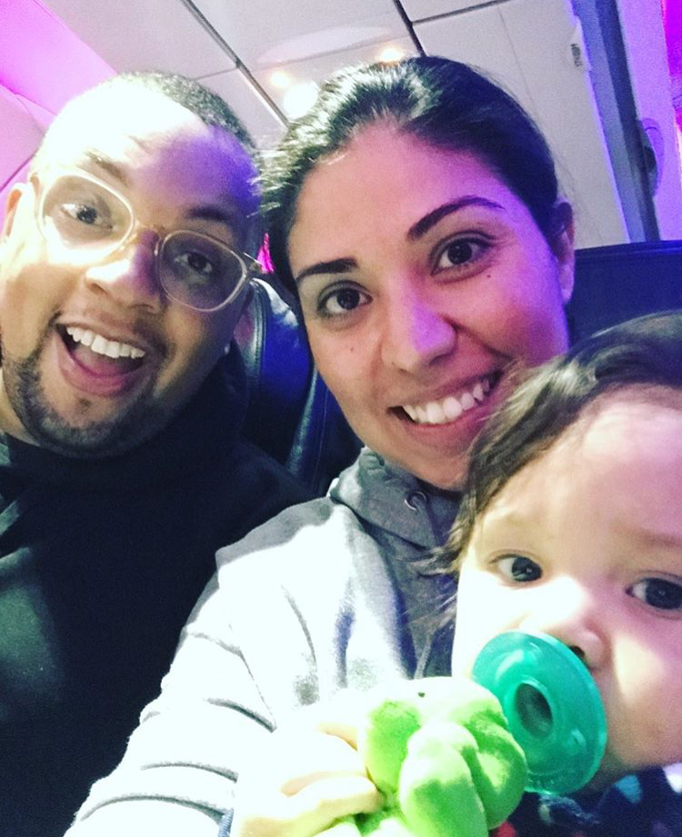 The Johnsons on their first flight as a family of three. Derreck, Vanessa, and Celine
