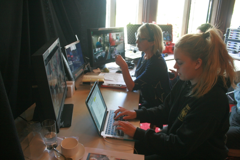In a makeshift production gallery, producer Amanda Murphy watches camera feeds of the historical re-enactment, while Royal Holloway media student Amy Clark (foreground) makes a detailed log of events.