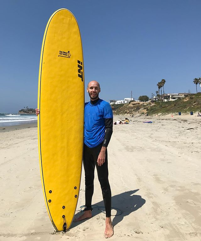 I learned to surf today! Also I couldn't smile normally because my jaw was very cold!