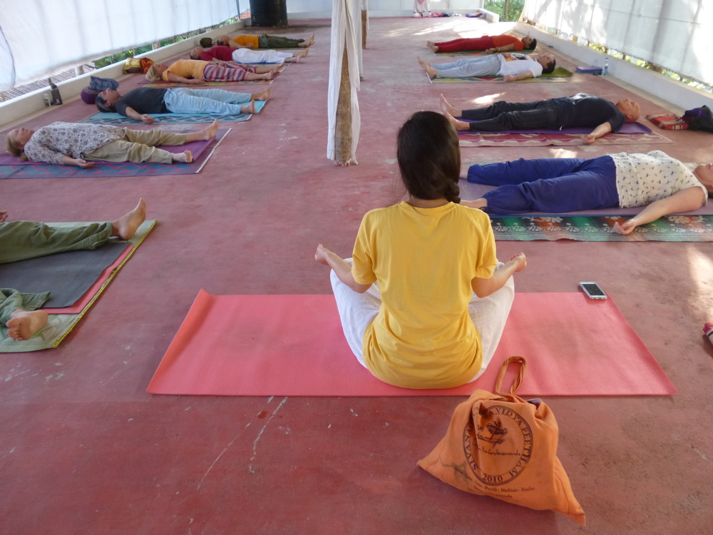 Teaching asana class in Varkala, India