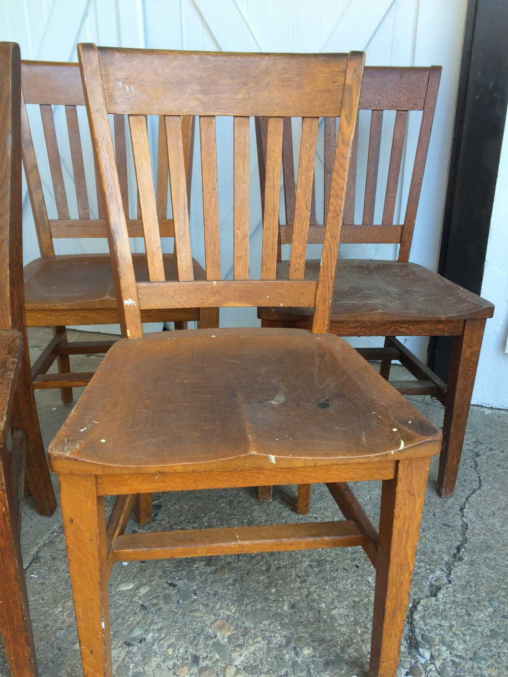 These sturdy oak chairs were reclaimed from an old library.