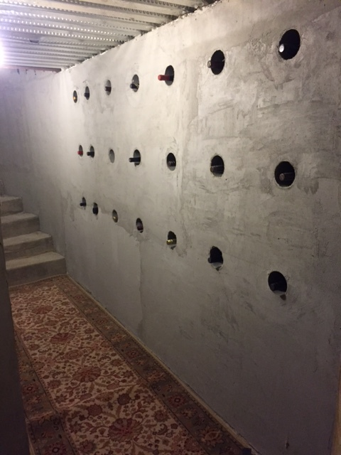 Plastic Sleeves placed in NUDURA wall create a feature wine wall