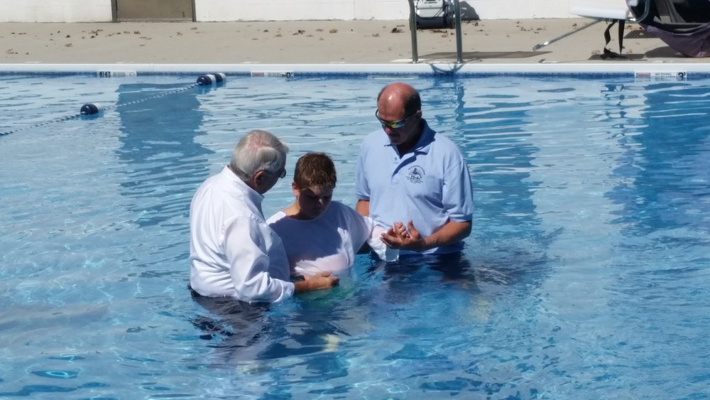 Baptisms of 2 new believers by Pastor Tom True of Star Baptist Church in the Pool at SBYCamp.
