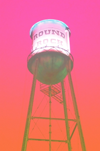 Round Rock water tower + pink/orange overlay