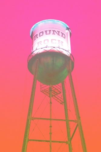 Round Rock water tower + pink/orange overlay