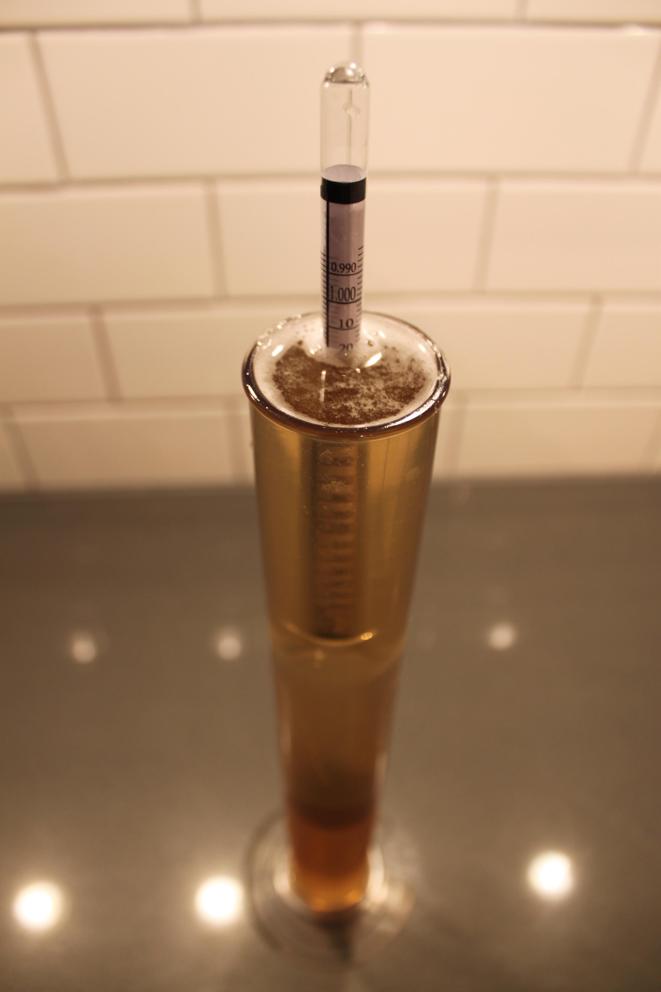Checking specific gravity with a hydrometer