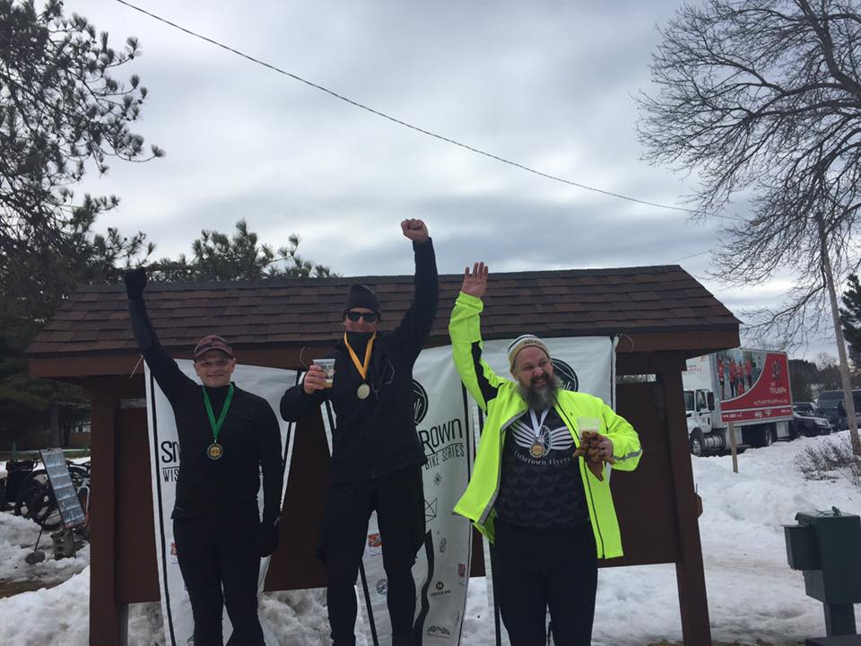 The men's short course 26-49 podium. 1st: Jim Rose, 2nd: Steve Toyne, 3rd: Jake Glatt, at right. Photo courtesy of Sarah Hardy.