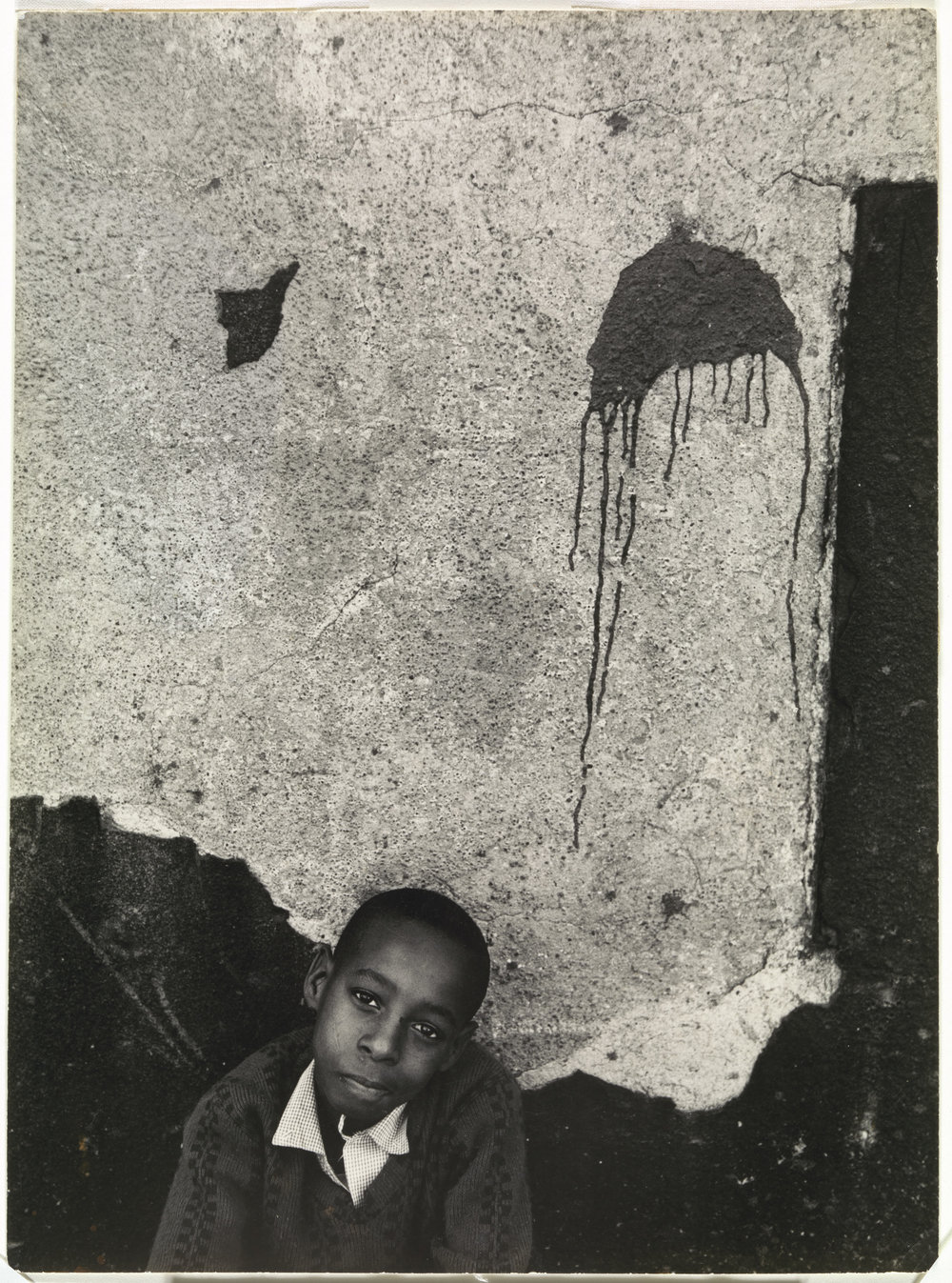 Boy with paint splatter,  Louis Draper (American, 1935-2002), gelatin silver print, 9 1/16 x 6 13/16 in. Virginia Museum of Fine Arts; Arthur and Margaret Glasgow Endowment.  Image © Louis H. Draper Preservation Trust