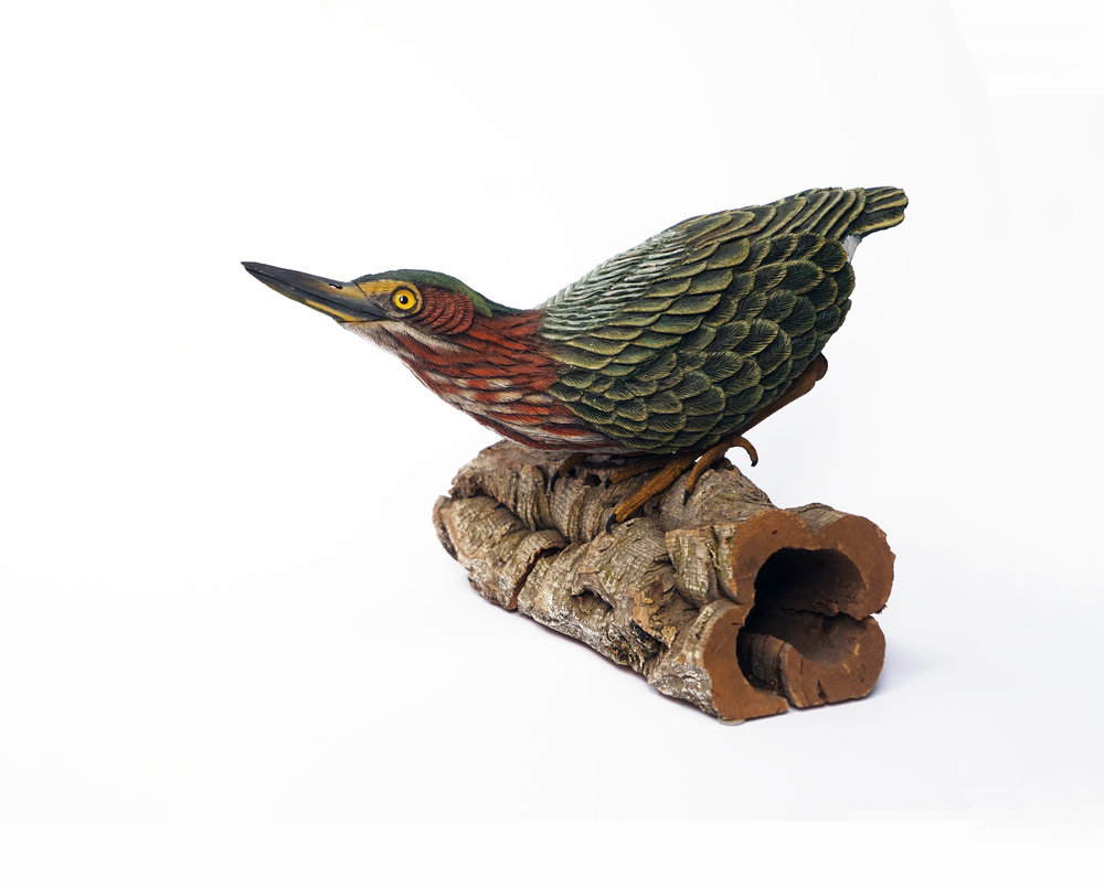 "Jim Comer,  Green Heron Crouching , tupelo wood w/cork bark base, 8"" x 10"" x 11"""