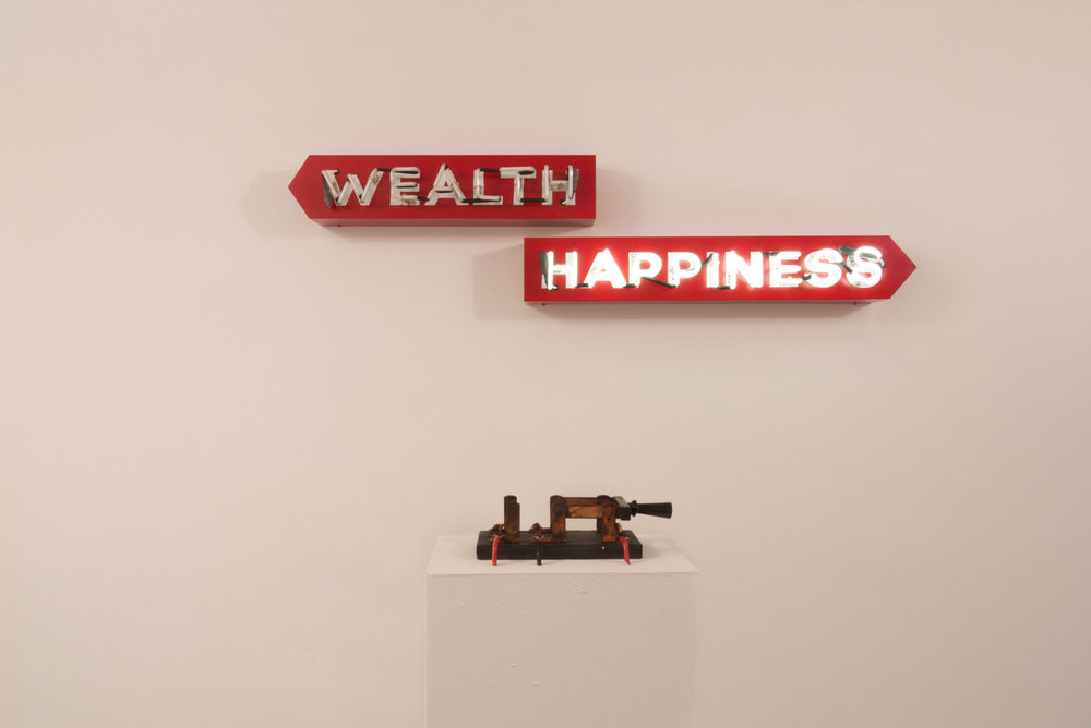 Steve Lambert (Purchase, NY)  Wealth or Happiness , 2012, aluminum, neon, enamel, electronics, antique knife switch 14 x 54 x 7.25 inches Courtesy of the artist