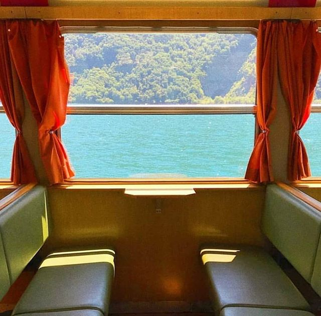 Come with us! . Pic by @daelamilk via @somewheremagazine . #train #sea #vintage #curtains #red #leatherseats #mountains #blue #wood #railway #photography #photographylovers #travel #traveller #travelgram #morethanaguesthouse #ibaiaetarramak