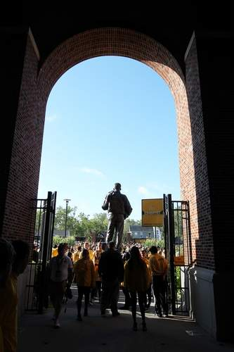 The stadium gates are closed after the Hawkeyes arrive past the Nile Kinnick statue at Kinnick Stadium in Iowa City on Saturday, Sept. 17, 2016. (Liz Martin/The Gazette)