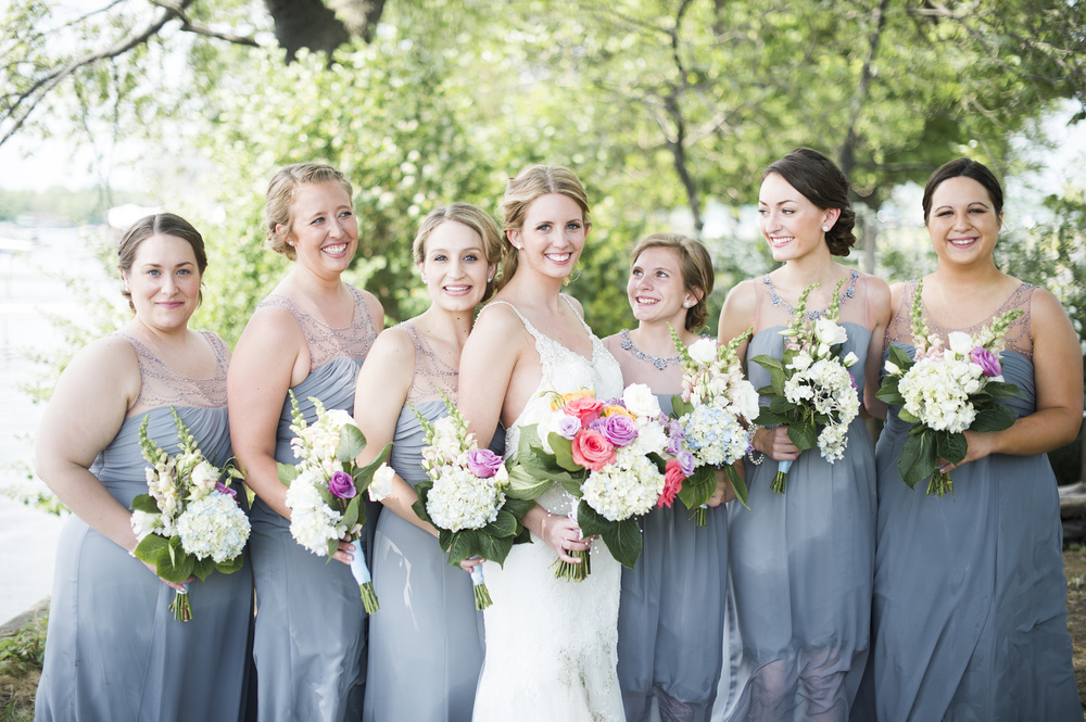 Can you see how wet these dresses are? Mud on brides dress and all still smiles.