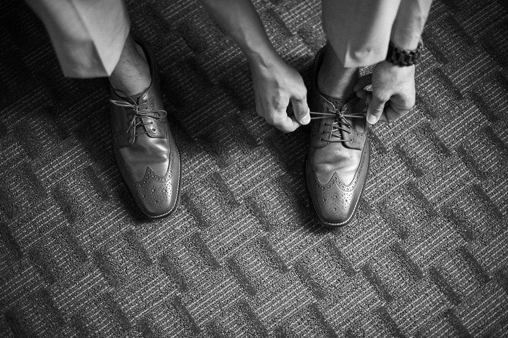 Groom Tying shoes in buffalo NY