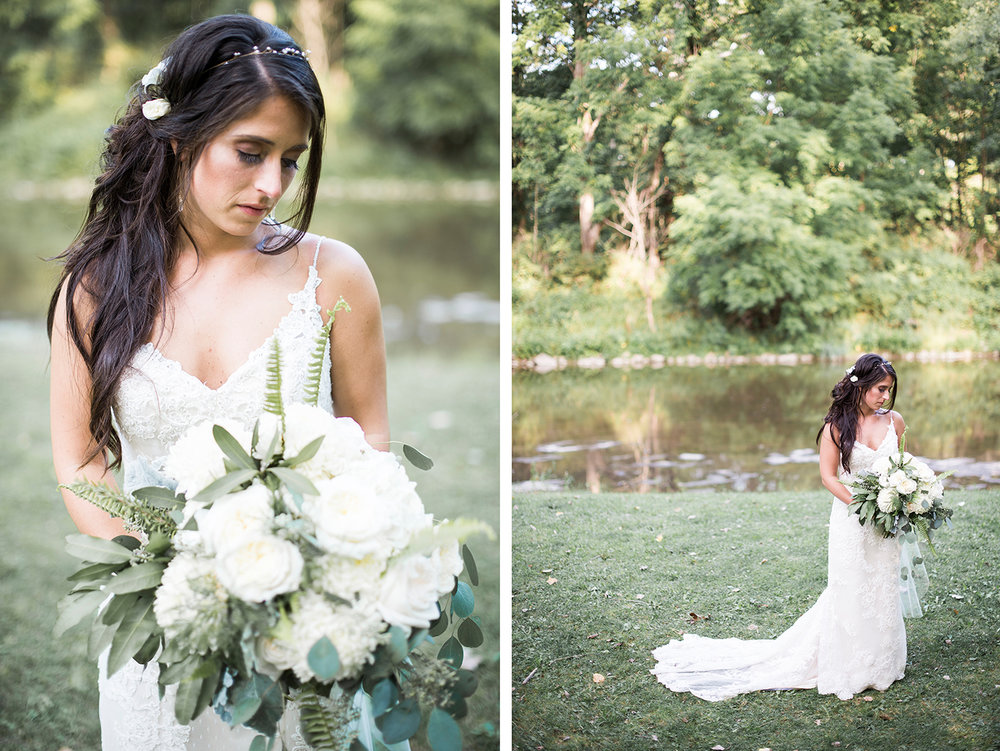 Bride standing in front of the river at Obriens in buffalo ny
