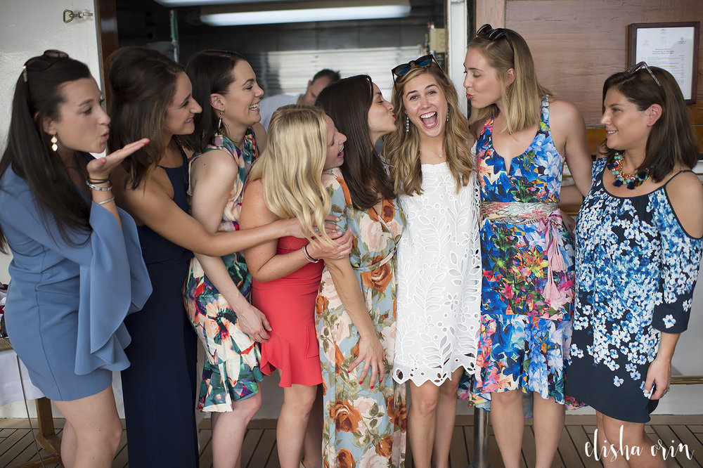 hanna-and-greggs-wedding-in-st-barts-on-the-sea-dream-boat-bridesmaids-blowing-kisses