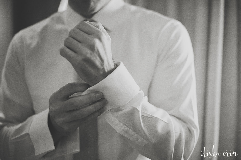 groom-putting-cuff-links-on-for-a-wedding-in-st-barts