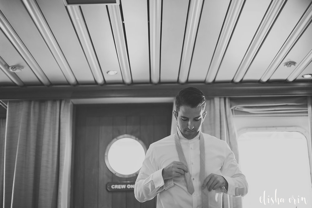 groom-tying-tie-on-sea-dream-yacht