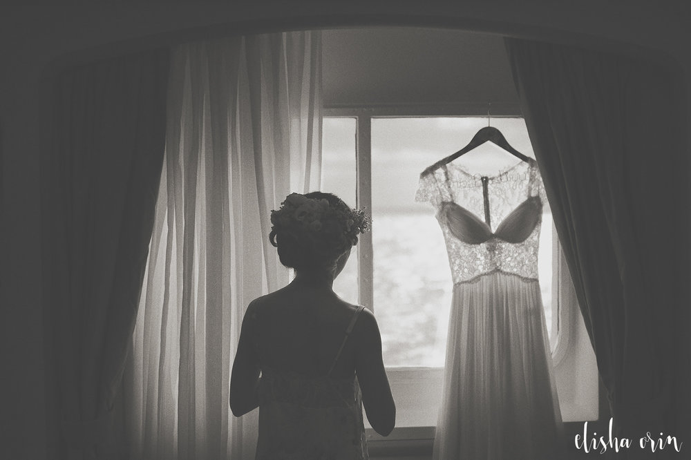 bride-looking-out-window-st-barths-wedding
