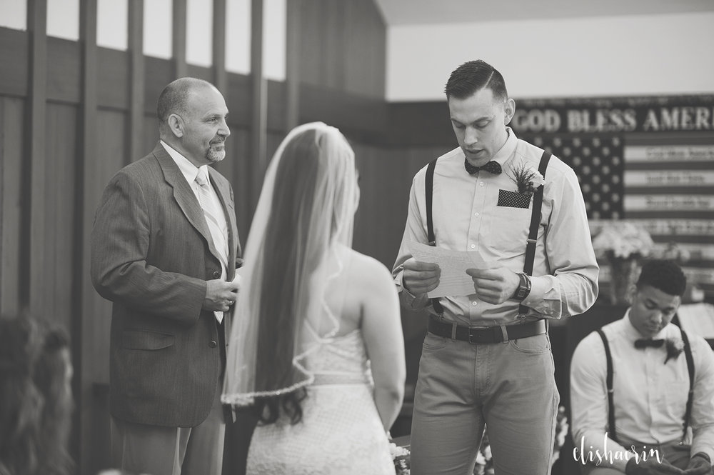 groom-reading-vows