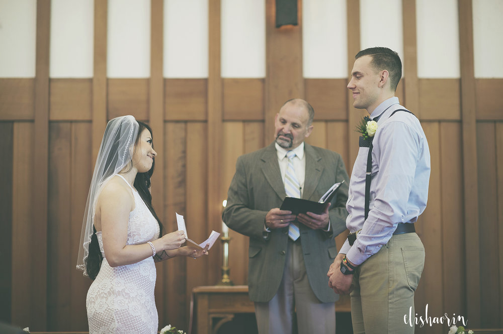 bride-and-groom-smiling-at-each-other-at-the-alter