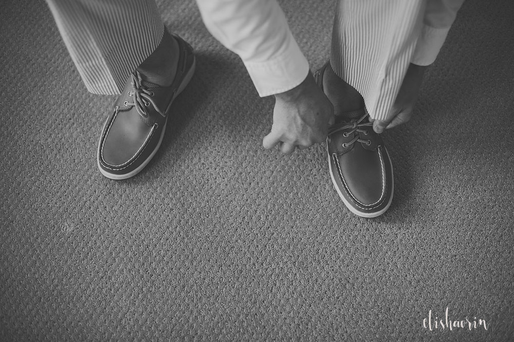 groom-getting-shoes-on-taken-in-st-john-by-elisha-orin-photography