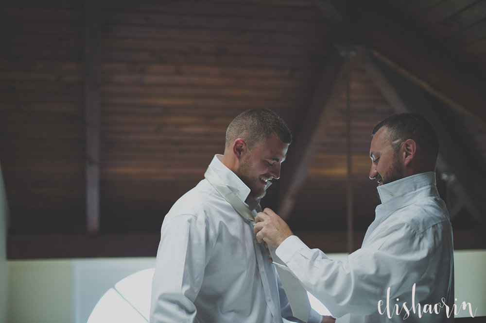 best-man-fixing-grooms-shirt-wedding-photography-by-st-john-photographer