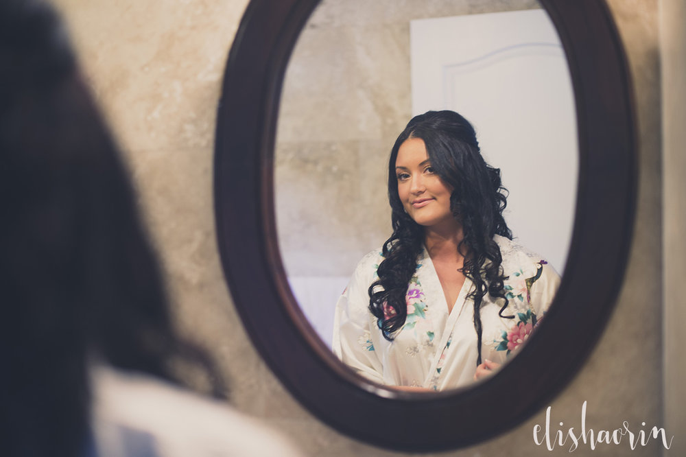 bride-looking-in-mirror-at-a-st-john-wedding