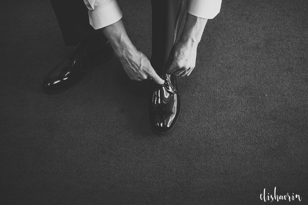 groom-getting-shoes-on-wedding-photography-in-jamestown-ny