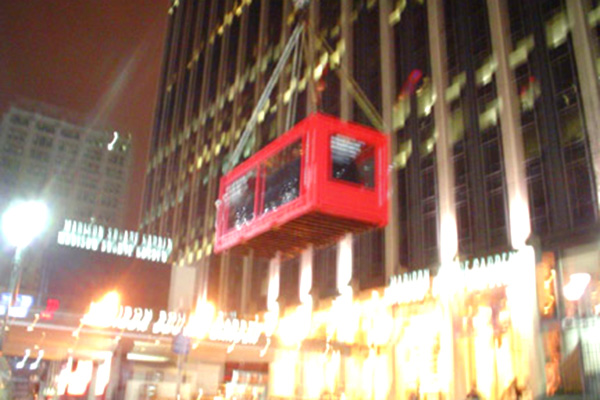 It takes the collaboration of many skilled and thoughtful people to airlift and install a shatter-proof reinforced box containing a Nissan Armada in front of Madison Square Garden for their launch.