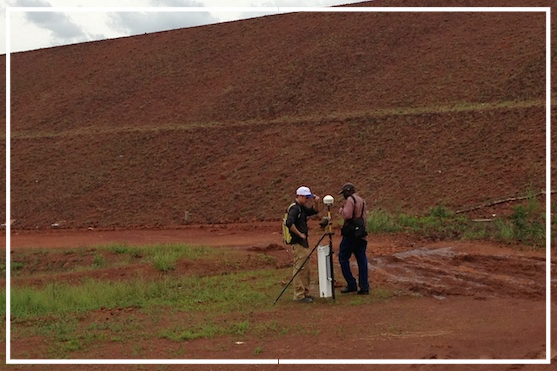 Field Technicians collecting measurements of the magnetic field generated by the electric current introduced to the water leaking from the dam.