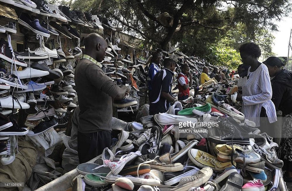 This man makes his living selling donated shoes at the Gikomba Open-Air Market in Kenya.