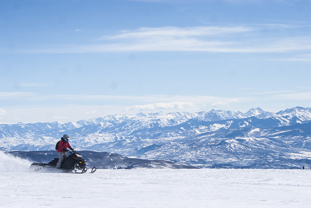 Bryan Myss, a kidney transplant recipient, sledding on the Flattops outside of Aspen, Colorado