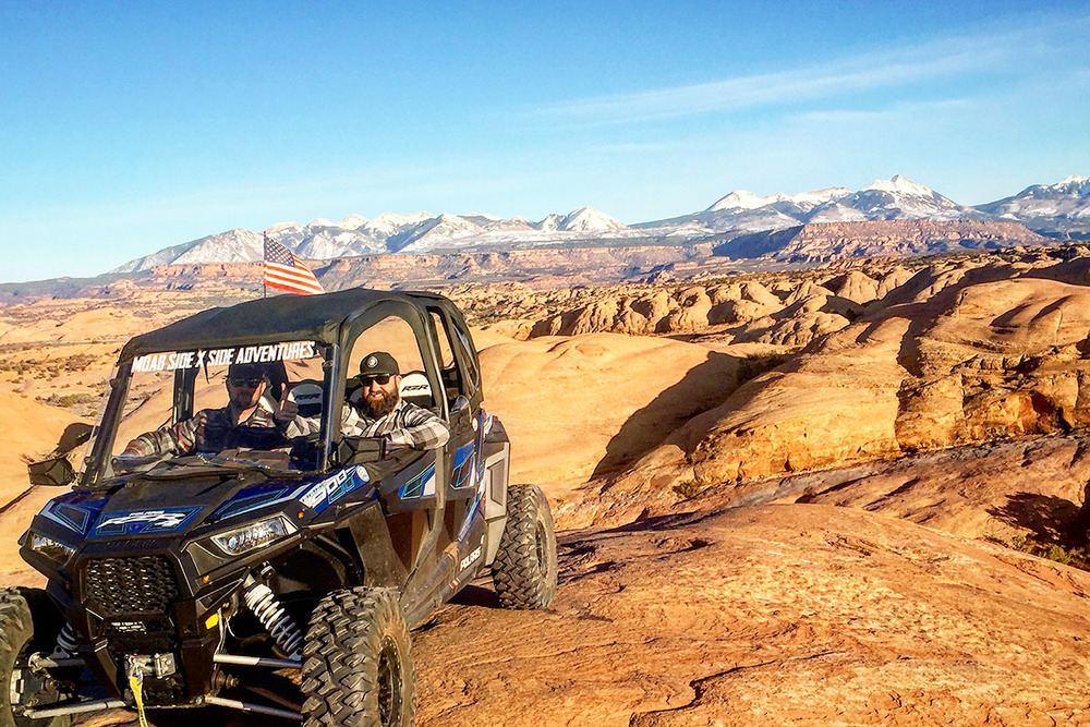 Rock crawling in a sport side-by-side on the slickrock in Moab, Utah