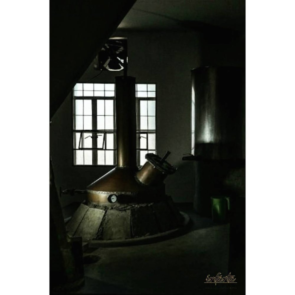 - The fire is ignited underneath the Copper still to prepare for coconut palm nectar distillation.