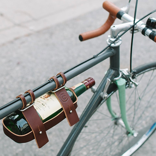Leather Bicycle Wine Carrier - For those fancy casual bike rides to the picnic in the park. Gotta ride in style. $40