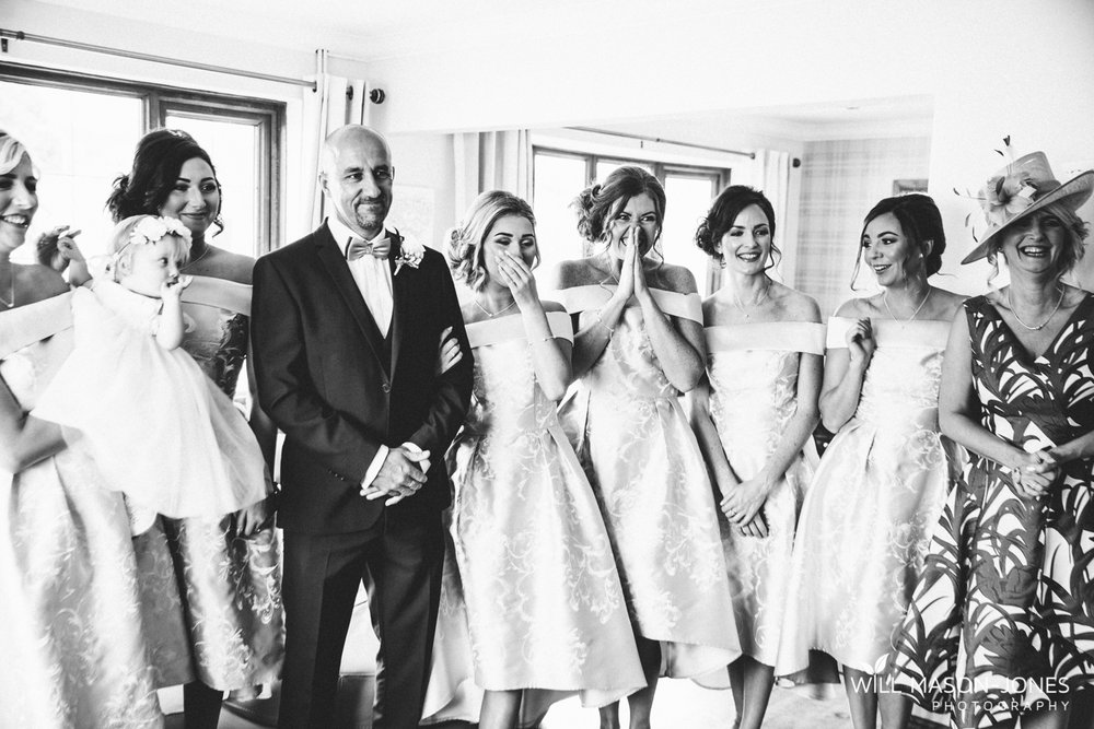 emotional wedding dress reveal with father and bridesmaids hensol castle wedding photographer cardiff