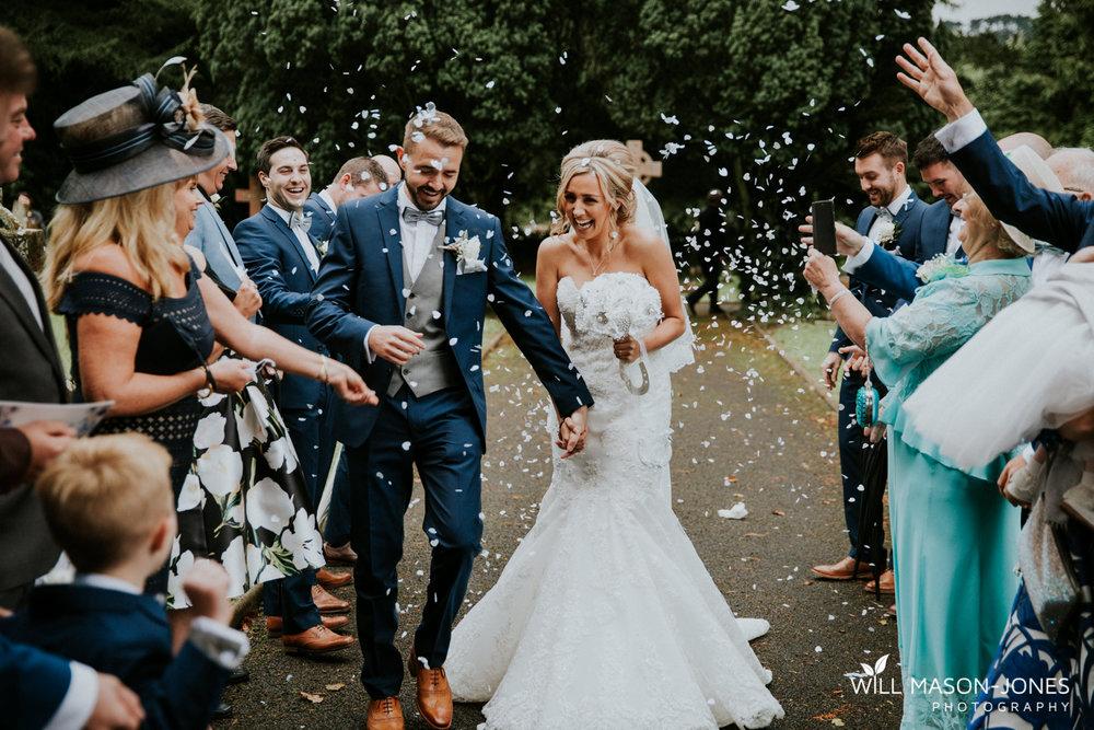 white confetti shower hensol castle wedding photographer cardiff