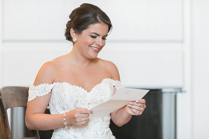 Bride Reading a Letter from her Groom on their Wedding Day