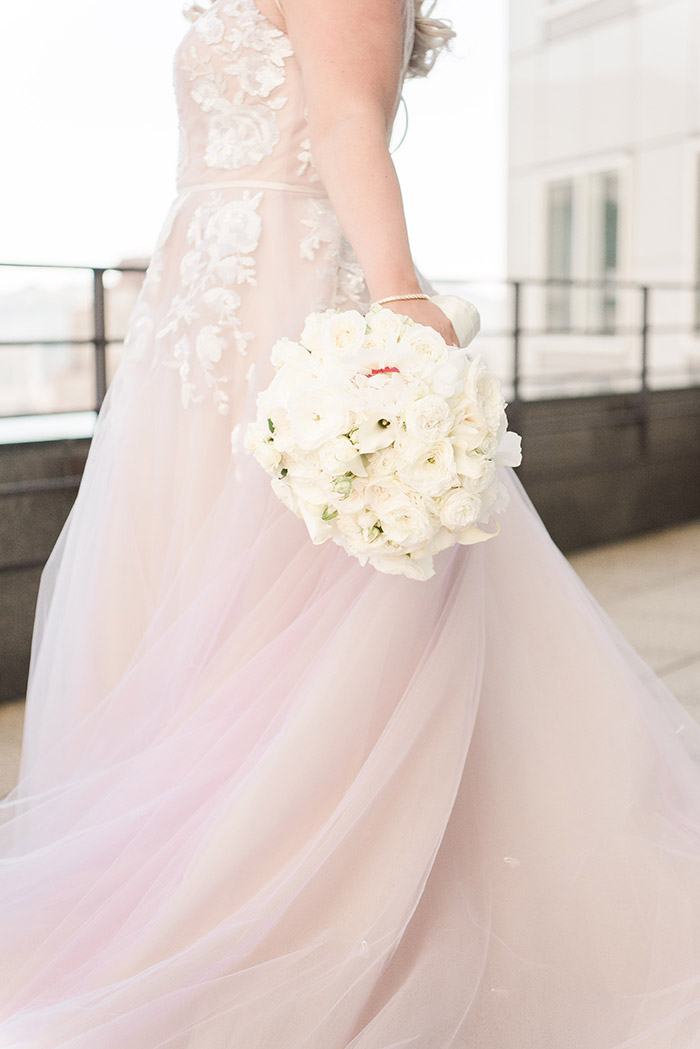 Blush Hayley Paige Wedding Dress with a White Bouquet
