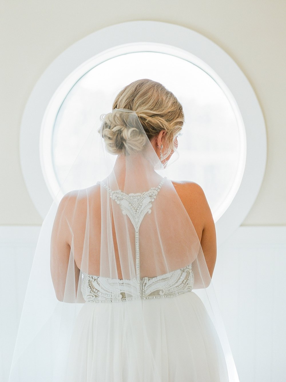Romantic Bridal Hairstyle with a Veil and Dramatic Back Wedding Dress