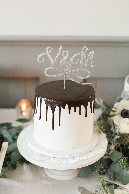 Modern Drip Cake with a Custom Silver Wedding Cake Topper
