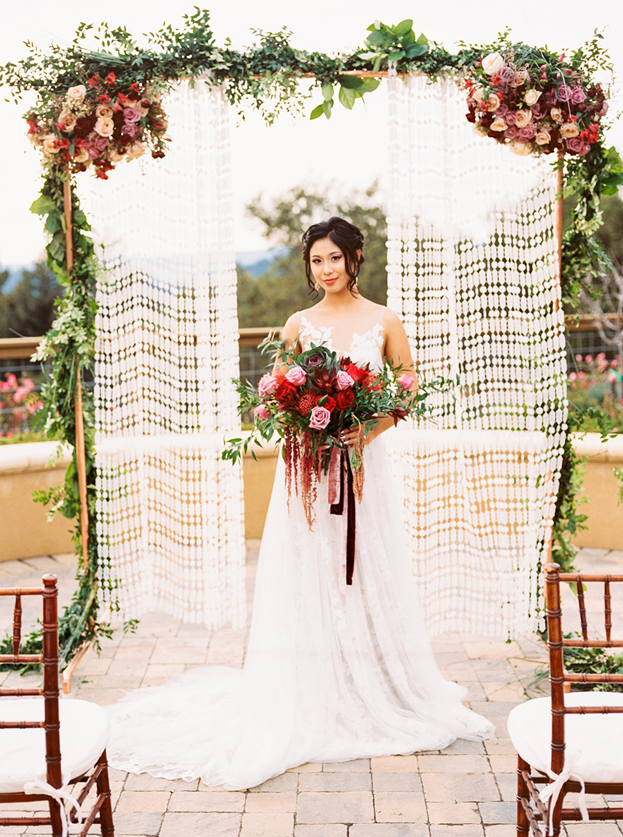 Macrame and Floral Bohemian Wedding Backdrop for a Winery Wedding in the Santa Cruz Mountains
