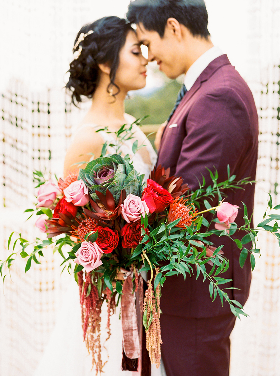 Luxe Bohemian Wedding Shoot with a Red and Pink Bouquet