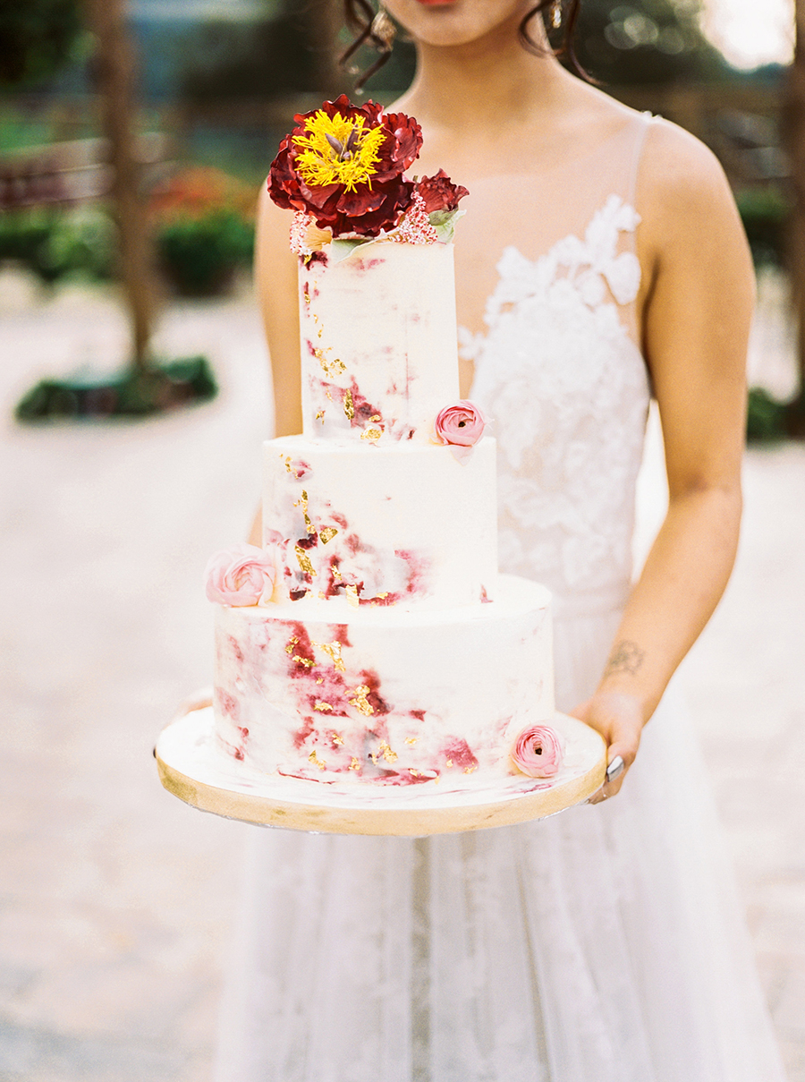 Marbled Wedding Cake with Gold Leaf and Flowers