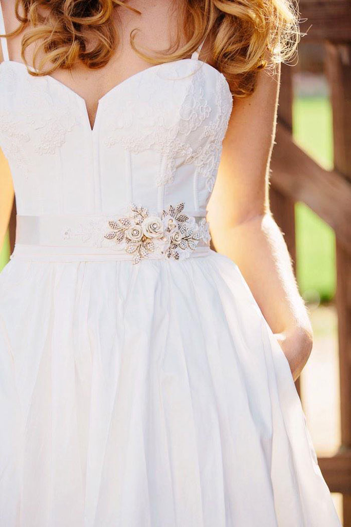 Timeless Bridal Style with a Lace and Flower Sash